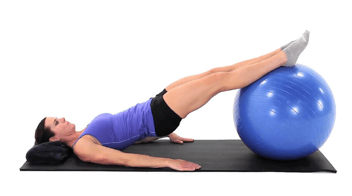 Woman Using Exercise Ball for Home Exercise